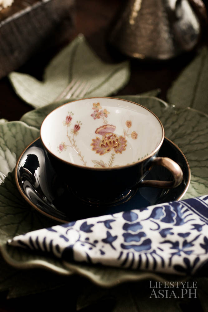 Although Stephanie usually does not favor flowers, a subtle hint shows in her Noritake cups