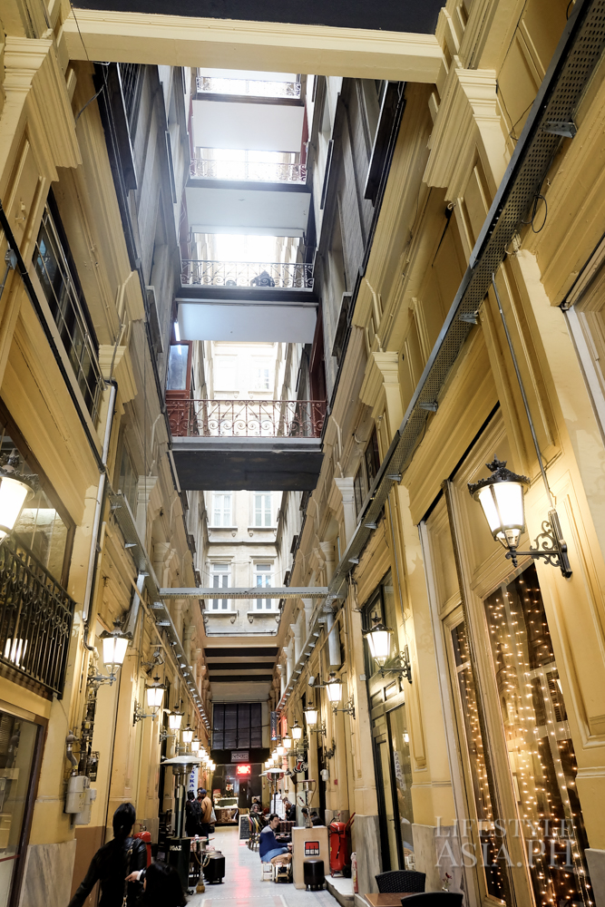 A historic building is now a shopping arcade with tea shops and music bars