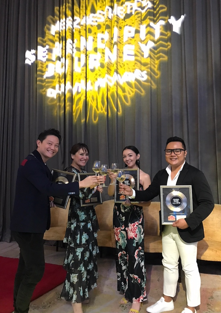 The Aivee Group team celebrates with a toast during the Bangkok ceremony