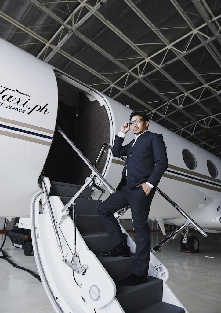 Paj Rodriguez outside a Gulfstream Business Jet (Photography by Hub Pacheco)