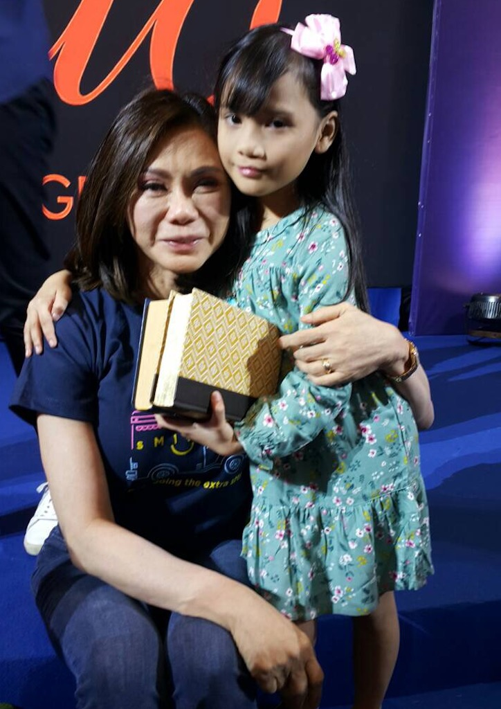 Vicki Belo with one of the beneficiaries of Belo Smiles.