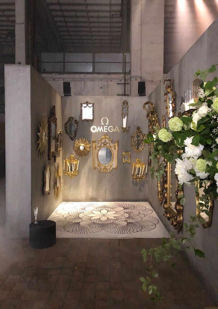 The industrial space was transformed into a surreal wonderland with vignettes recreating fairytales set against raw concrete interiors.