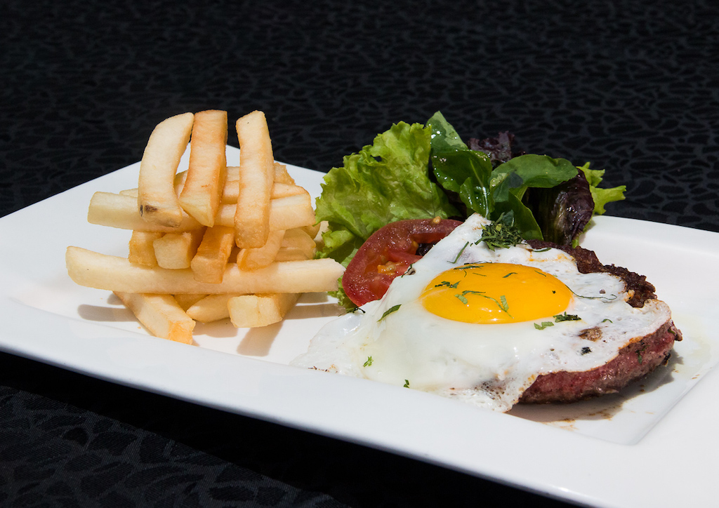 Steak á Cheval - A beef steak topped with a fried egg.