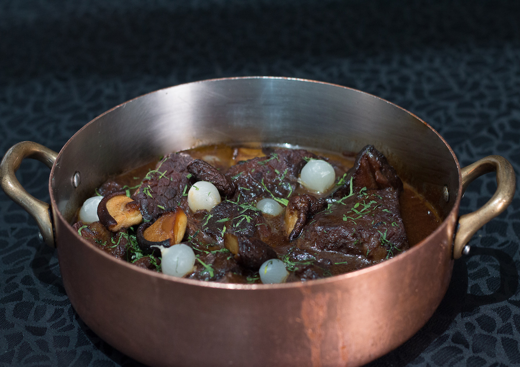 Beef bourguignon - stew prepared withbeefbraisedinred wine, traditionally redBurgundy, and beef broth, generally flavored withgarlic,onionsand abouquet garni, withpearl onionsand mushrooms added towards the end of cooking.