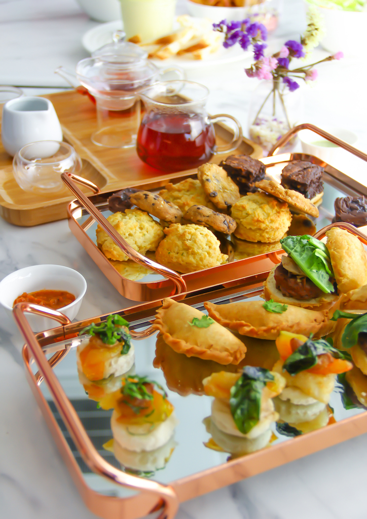 Two platters are served during afternoon tea. One with sweet confections, the other with savory treats
