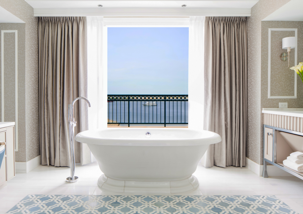 The master bath is equipped with Carrara marbled bath, a double-vanity free-standing soaking tub overlooking the harbor, a Toto toilet, separate rain shower and a personal dressing room. Amenities are by Bulgari. (Photo courtesy of Boston Harbor Hotel)