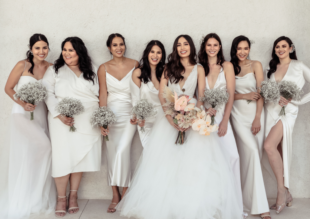 Martine Cajucom with her bridal party (Photograph by Mango Red)