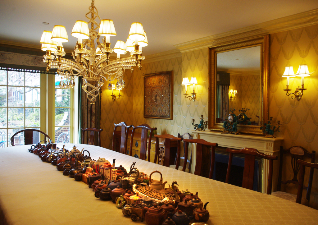 The mahogany dining table can seat 22 guests